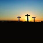 Three crosses in sunset